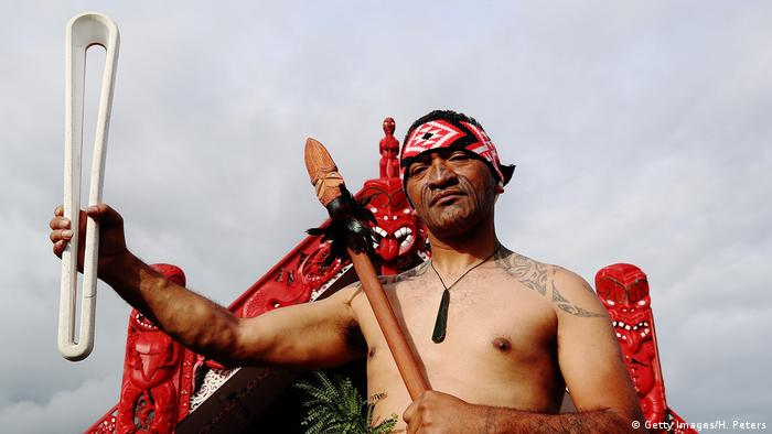 A Maori warrior carries the Queen's Baton, the Commonwealth Games equivalent of the Olympic Torch. (Getty Images/H. Peters)