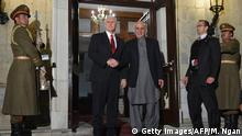 December 21, 2017 US Vice President Mike Pence (L) poses with Afghan President Ashraf Ghani upon arrival at the Presidential Palace in Kabul on December 21, 2017. POOL / AFP PHOTO / POOL / MANDEL NGAN (Photo credit should read MANDEL NGAN/AFP/Getty Images)