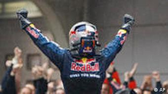 Red Bull Formula One driver Sebastian Vettel of Germany stands on his car and celebrates to his team after winning the during the Chinese Formula One Grand Prix