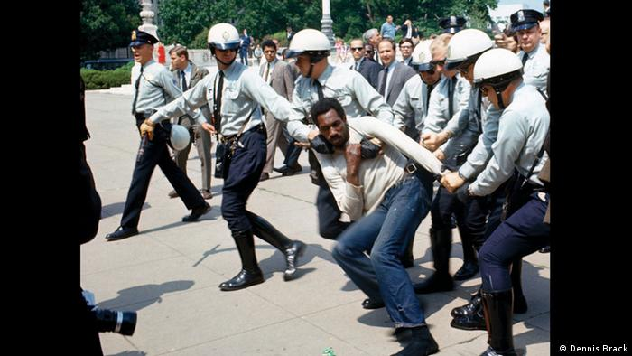 Ray Robinson, a US civil rights activist, being dragged with a police baton at his throat while being arrested outside the US Supreme Court, around 1968 (Dennis Brack)