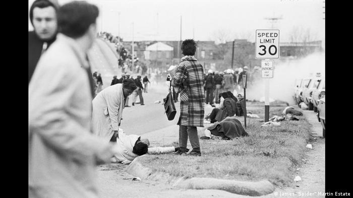 Amelia Boynton is assisted as she lies on the ground with other injured civil rights marchers after being attacked by Alabama state troopers during the Selma to Montgomery March for Voting Rights, 1965 (Spider Martin)
