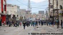 20.12.2017 *** A picture taken on December 20, 2017 shows demonstrators gathering in a street in the city of Raniya, 130 kilometres north of Sulaymaniyah in the autonomous Iraqi Kurdistan region, as protests against political corruption raged for a third day despite a clampdown by security forces after five people were killed. Protesters have unleashed their fury at all five of the autonomous Kurdish region's main political parties, not just the Kurdistan Democratic Party (KDP) of former regional president Massud Barzani who organised the fateful poll for independence in September 2017 which drew sweeping reprisals from Baghdad and dealt a heavy blow to the region's already flagging economy. / AFP PHOTO / SHWAN MOHAMMED (Photo credit should read SHWAN MOHAMMED/AFP/Getty Images)