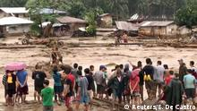 People help to rescue flood victims in Lanao Del Norte, Philippines, December 22, 2017 in this image taken from video footage obtained from social media. Climah Cabugatan Disumala/via REUTERS THIS IMAGE HAS BEEN SUPPLIED BY A THIRD PARTY. MANDATORY CREDIT. NO RESALES. NO ARCHIVES. MUST ON SCREEN COURTESY ACLIMAH CABUGATAN DISUMALA