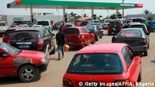 Luanda residents queue with their cars at a gas station on December 21, 2017 in Luanda, Angola. Angola has suffered a week of fuel shortages, a bitter irony for one of Africa's leading oil producers, and a hardship that some people blame on opponents of incumbent President. The majority of petrol stations in the capital Luanda have had long lines of motorists for seven days now, all waiting for the chance to fill up their tanks. / AFP PHOTO / AMPE ROGERIO (Photo credit should read AMPE ROGERIO/AFP/Getty Images)