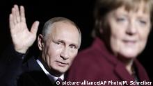 President of Russia Vladimir Putin waves after he meets German Chancellor Angela Merkel for a summit with the leaders of Russia, Ukraine and France at the chancellery in Berlin, Wednesday, Oct. 19, 2016. (AP Photo/Markus Schreiber) |