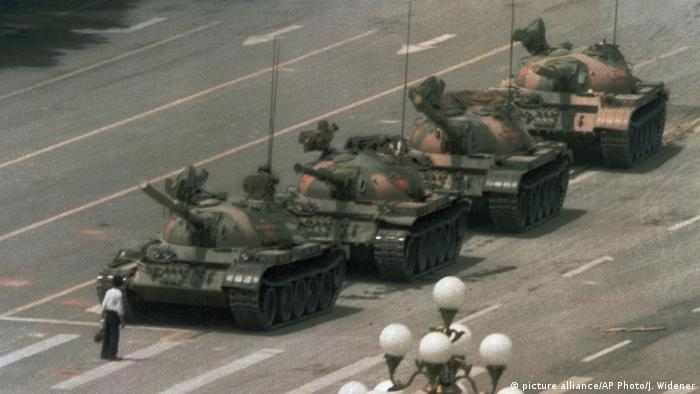 A Chinese man stands alone to block a line of tanks heading east on Beijing's Changan Blvd