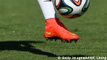 Portugal's forward Cristiano Ronaldo, wearing a strap on his left knee controls the ball during a training session at the team's base camp in Campinas on June 13, 2014, during the 2014 FIFA World Cup football tournament in Brazil. AFP PHOTO/ FRANCISCO LEONG (Photo credit should read FRANCISCO LEONG/AFP/Getty Images)