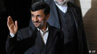 Iranian President Mahmoud Ahmadinejad waves as he arrives at the conference in Geneva