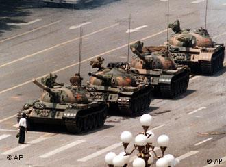 A Chinese protestor blocks a line of tanks heading east on Beijing's Cangan Blvd. June 5, 1989 in front of the Beijing Hotel. The man, calling for an end to the violence and bloodshed against pro-democracy demonstrators, was pulled away by bystanders, and the tanks continued on their way. (AP Photo/Jeff Widener)