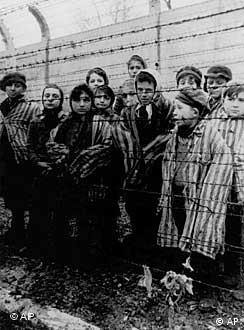 Children behind barbed wire as they were liberated from the Nazi concentration camp at Auschwitz, Poland in 1945