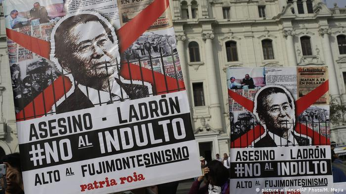 Protesters rally against the president's decision to pardon ex-President Alberto Fujimori