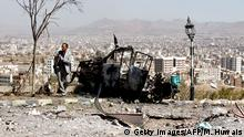 A Yemeni man takes a picture of the debris following an airstrike by the Saudi-led coalition on the guard house of a memorial to Egyptian soldiers in the southern Sanaa neighbourhood of Aser on December 25, 2017. Seven members of a family died Monday in an air raid near Sanaa, told AFP a witness who brought first aid to the victims. The raid, attributed by this witness to Saudi-led coalition aviation, targeted early in the morning the guard house of a memorial to Egyptian soldiers killed in Yemen in the 1960s. / AFP PHOTO / MOHAMMED HUWAIS (Photo credit should read MOHAMMED HUWAIS/AFP/Getty Images)