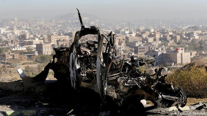 Wreckage of a car after an air strike
