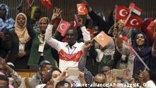 Students cheer as Turkey's President Recep Tayyip Erdogan addresses after he received a honorary doctorate from Khartoum University in Khartoum, Sudan, Monday, Dec. 25, 2017. Erdogan is in Sudan for a two-day State visit.(Kayhan Ozer/Pool Photo via AP) |