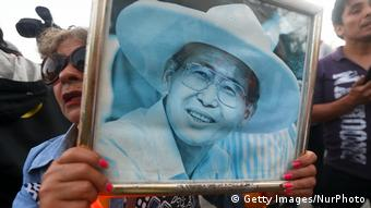 A supported of Fujimori holds up his image outside the hospital in Lima (Getty Images/NurPhoto)