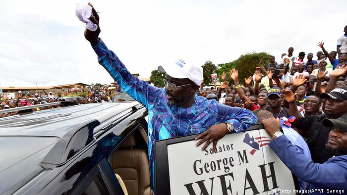 George Weah waves at his supporters during a campagin rally in Monrovia (Getty Images/AFP/I. Sanogo)