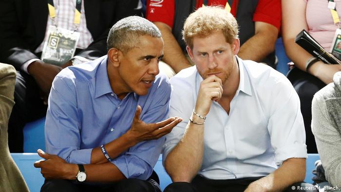 Barack Obama leans in and talks with Prince Harry during the Invictus Games in Toronto in September.