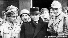 Benito Mussolini is shown in front of a hotel in Gran Sasso Mountain area of Italy in Sept. 1943 during World War II. Gathered around the overthrown Italian dictator are German paratroopers who rescued him from imprisonment. (AP Photo) |