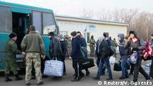 27.12.2017 *** Prisoners of war (POWs) from the separatist self-proclaimed Luhansk People's Republic (LNR) board a bus during the exchange of captives near the city of Bakhmut in Donetsk region, Ukraine December 27, 2017. REUTERS/Valentyn Ogirenko