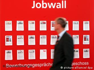 A job hunter looking at an advertisement board in Hanover