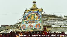 Lamas pray in front of a huge thangka during a buddha unveiling ceremony at the Molang Festival at the Kirti Monastery in Aba county in Aba Tibetan Autonomous Prefecture in southwest China's Sichuan province on Tuesday, Feb. 23, 2016. The Molang Festival, originated from the first month of the Tibetan calendar in 1409, was the day when Tsongkhapa, the master of Gelug Sect of Tibetan Buddhism gave first sermons in the Jokhang Monastery in Lhasa and prayed for blessings.(Photo By Stu/Color China Photo/AP Images) |
