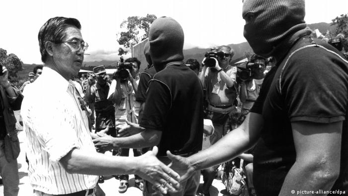 Former President Alberto Fujimoro shakes hands with one of the leaders of Shining Path