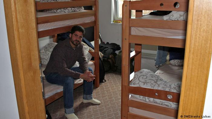 Nasib Khan sits in a small room filled with bunk beds