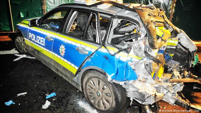 A demolished German police car after having been rammed by a Ukrainian semi