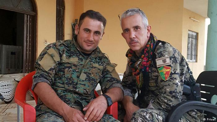 Marcos poses with a fellow fighter in ranks of the YBS in Sinjar