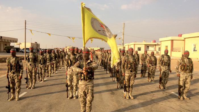 New recruits of the Syrian Democratic Forces march during a graduation ceremony in Iraq in September 2017