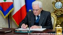 Italian President Sergio Mattarella signs a decree to dissolve parliament at the Quirinale Presidential palace in Rome, Italy, December 28, 2017. Presidential Press Office/Handout via Reuters ATTENTION EDITORS - THIS IMAGE WAS PROVIDED BY A THIRD PARTY. NO RESALES. NO ARCHIVE