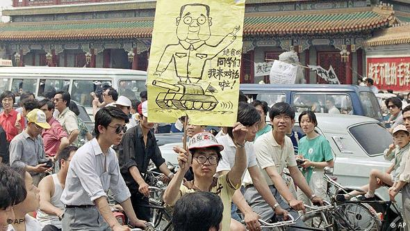 Students picket Communist Party headquarters in Beijing, May 28, 1989, calling for the ouster of Premier Li Peng. Poster at center is a caricature of Li sitting on a tank. (AP Photo/Mark Avery)