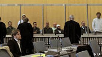 The defendents appear in in the courtroom in Duesseldorf.