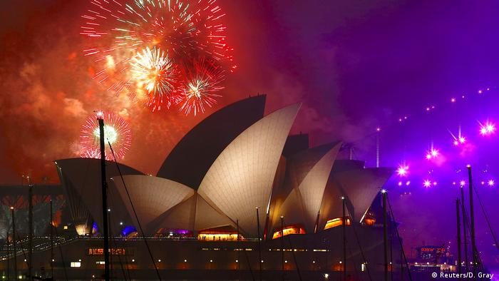 Fireworks explode near the Sydney Opera House as part of new year celebrations on Sydney Harbour, Australia (Reuters/D. Gray)