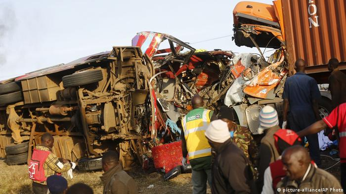 The mangled wreckage of a bus and truck after a head on collision.