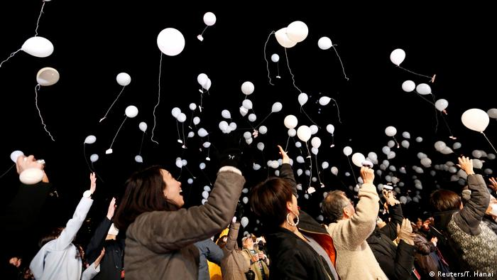 People release balloons as part of a New Year countdown event in Tokyo