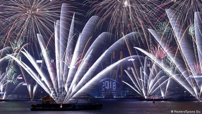 Fireworks over Victoria Harbour and Hong Kong Convention and Exhibition Centre in Hong Kong
