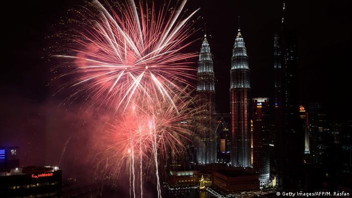 Fireworks near Malaysia's Petronas Twin Towers during New Year celebrations in Kuala Lumpur