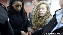 01.01.2018 *** Palestinian teen Ahed Tamimi (R) enters a military courtroom escorted by Israeli Prison Service personnel at Ofer Prison, near the West Bank city of Ramallah, January 1, 2018. REUTERS/Ammar Awad