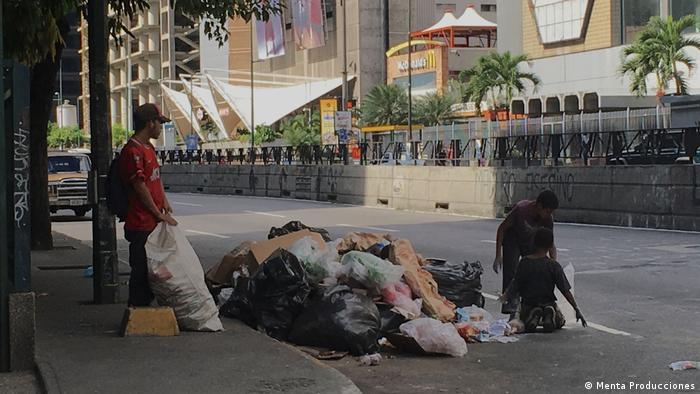 People searching in garbage