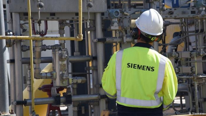 Unions protest Siemens job cuts as company posts profit | Business