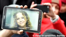 Phone screen showing Iryna Nozdrovska (Getty Images/AFP/S. Supinsky)