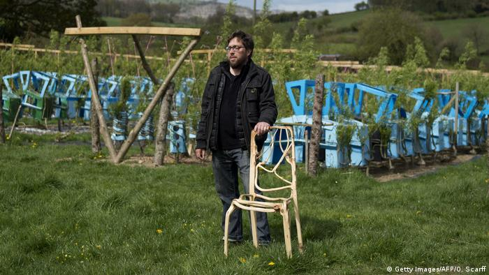 Gavin Munro presenting his grown chair design (Getty Images/AFP/O. Scarff)