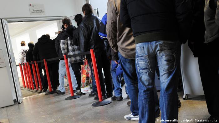 Migrants standing in line