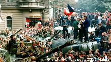Czech youngsters holding Czechoslovak flag stand atop an overturned truck as other Prague residents surround Soviet tanks in downtown Prague on 21 August 1968 as the Soviet-led invasion by the Warsaw Pact armies crushed the so called Prague Spring reform in former Czechoslovakia thirty years ago. This Thursday sees the 30th anniverary of the invasion of Czechoslovakia by Warsaw Pact troops to crush reforms by communsit leader Alexander Dubcek. dpa |