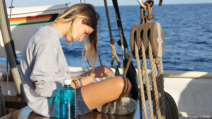 Blogger Lisa on deck of a Ocean College boat