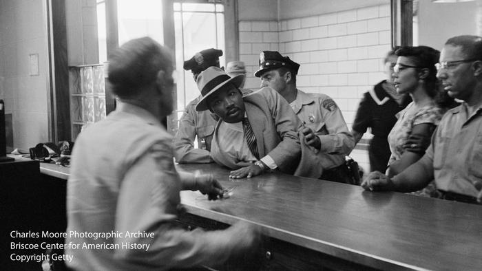 Martin Luther King, Jr., one of the key civil rights movement leaders, is arrested on trumped-up charges of loitering in Montgomery, Alabama, in 1958