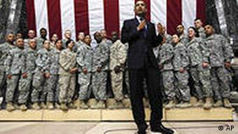 ** ADVANCE FOR TUESDAY, APRIL 28 AND THEREAFTER ** FILE - In this April 7, 2009 file photo, President Barack Obama addresses military personnel at Camp Victory in Baghdad, Iraq. (AP Photo/Charles Dharapak, FILE)