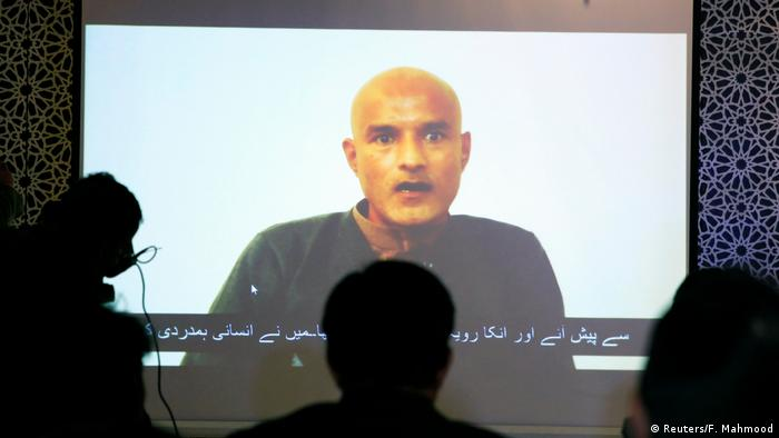 Jadhav seen on a screen during a news conference at the Ministry of Foreign Affairs in Islamabad on December 25, 2017