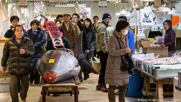 Customers walk through Tsukiji fish market in Tokyo. (Getty Images/Tomohiro Ohsumi)